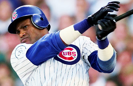 Chicago Cubs rightfielder Sammy Sosa watch his 60th home run of the season leave the park during the seventh inning against the Milwaukee Brewers at Wrigley Field in Chicago, Saturday, Sept. 12, 1998. Lance Johnson and Mark Grace were on base at the time. (AP Photo/Beth A. Keiser)
